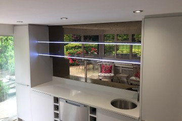 Edge-Lit Shelves with Antique Mirror Splashbacks
